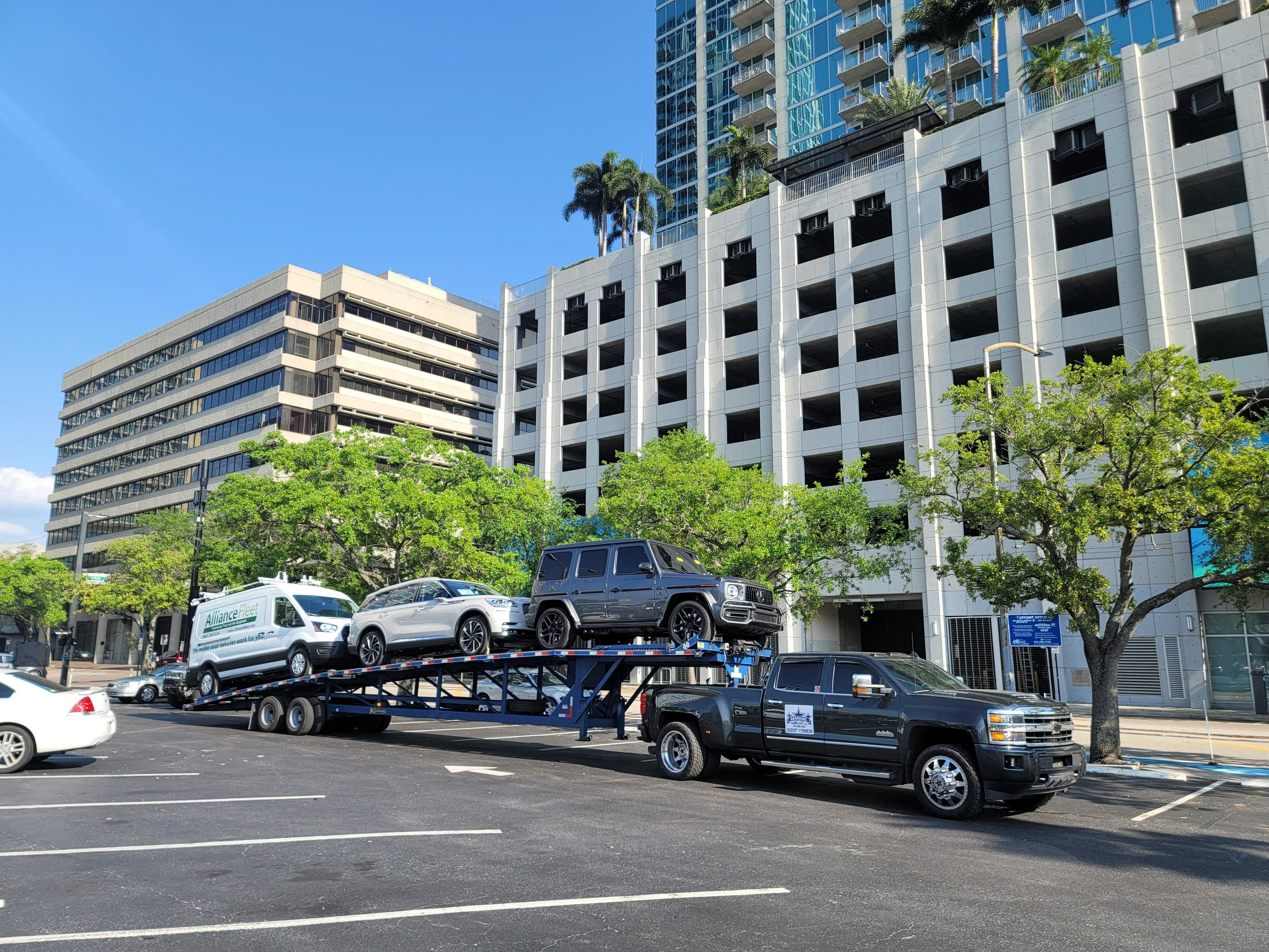 three vehicles on a trailer