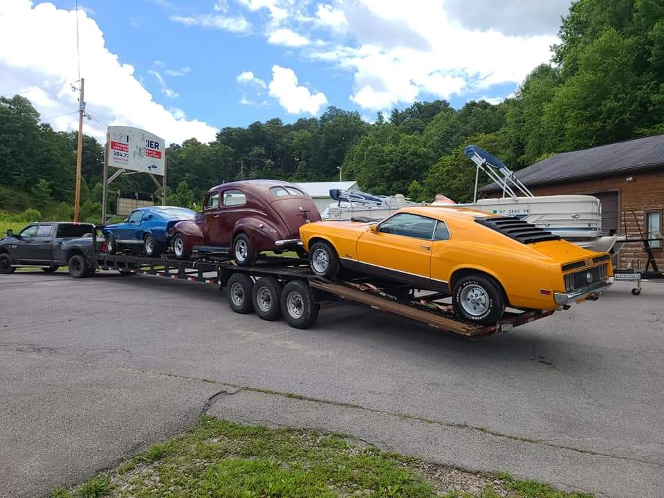 antique mustang on a trailer